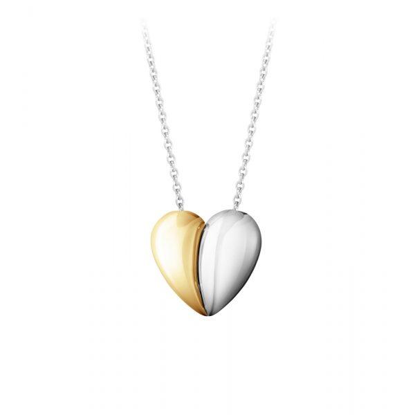 Mestergull To halvdeler som passer perfekt sammen danner det evige symbolet på kjærlighet, et hjerte. Curve anhenget er laget av sterlingsølv og 18 karat gult gull GEORG JENSEN Heart Anheng