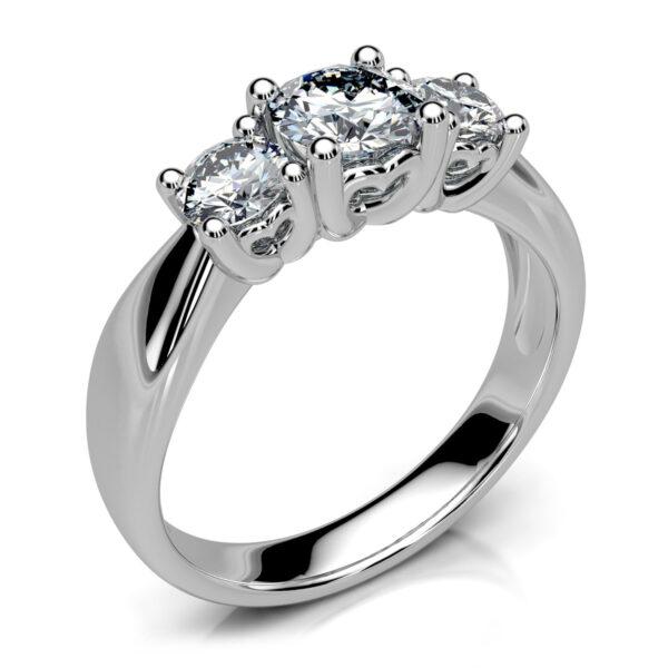 Mestergull Klassisk trestens ring utviklet for kunde. Ringen er utført i hvitt gull 585 og fattet med 3 diamanter. Totalt 0,94 ct. HSI DESIGN STUDIO Spesialdesign Ring