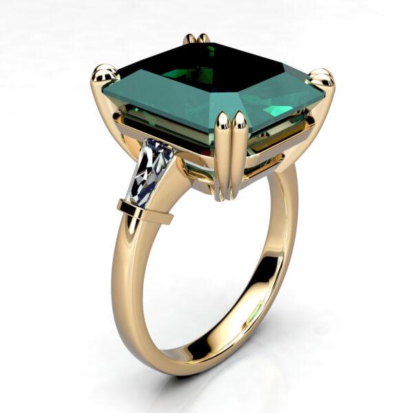 Mestergull Ring i gult gull utviklet for kunde. Ringen er fattet med Turmalin på 11,8 x 14,1 mm og trapesformede diamanter på sidepartiene. Totalt 0,31 ct. DESIGN STUDIO Spesialdesign Ring