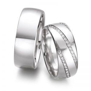 Mestergull Et klassisk par ringer i hvitt gull med diagonalt fattede diamanter rundt hele ringen. Prisen nedenfor er pr. ring uten diamanter da disse kan velges helt etter ønske og budsjett. LYKKERINGENE Eksempel Ring