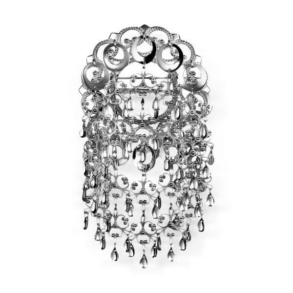 Mestergull En falntastisk sølje i oksidert sølv med 12 blanke ringløv (skåler) med Doble heng som definitivt vil sette preg på bunaden. NORSK BUNADSØLV Sølje