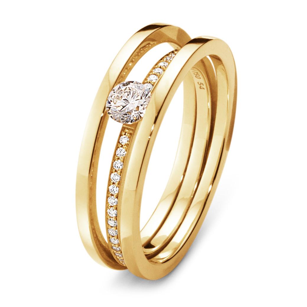 Mestergull HALO enstensring i 18 kt. gult gull med brilliantslipte diamanter. Antall av diamanter og vekt i karat varierer med ringstørrelsen GEORG JENSEN Halo Ring