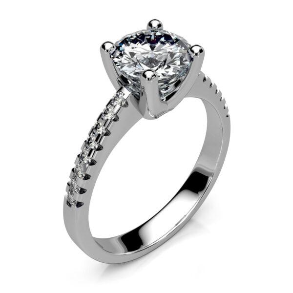 Mestergull Elegant solitaire enstens diamantring med avrundede former utført i hvitt gull 585. Ringen er fattet med 17 diamanter. Hovedstenen er 1,14 ct. I SI3 og skuldrene er fattet med 16 brillianter à 0,01 ct. HSI. Totalt 1,30 ct. DESIGN STUDIO Solitaire Ring