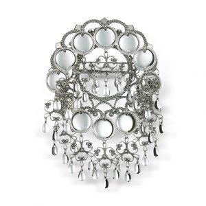 Mestergull En ekstravagant sølje i oksidert sølv som definitivt vil sette preg på bunaden. Den er utsmykket med 12 blinkende trådkantløv (skåler) og heng. NORSK BUNADSØLV Sølje