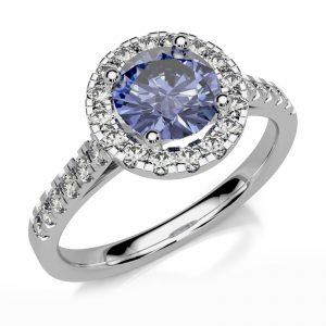 Mestergull Ring utviklet til kundens tanzanite omkransen med 16 diamanter. Ringen er utført som en petit modell i hvitt gull 585 DESIGN STUDIO Spesialdesign Ring