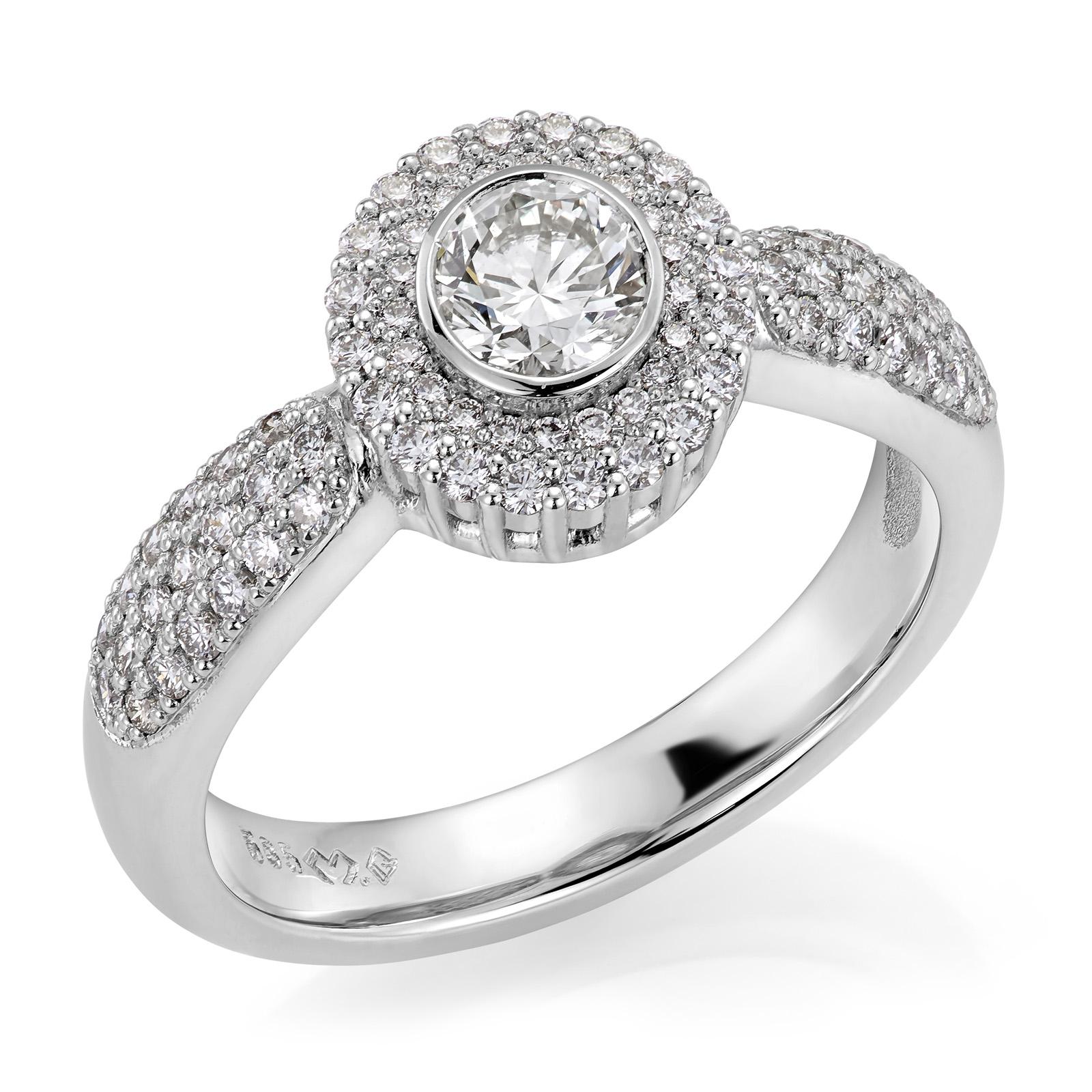 Mestergull Spesialutviklet ring for kunde i hvitt gull med 79 diamanter, totalt 1,46 ct. HSI. Senterstenen er 0,80 ct. og pavèringen er utført med billianter i størrelser mellom 1,0 og 1,4 mm DESIGN STUDIO Spesialdesign Ring