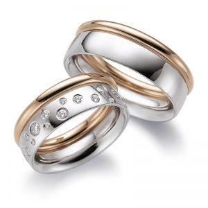 Mestergull En spennende kombinasjon med sammesetning av to ringer. En rund i rødt gull i profil 1 og en i hvitt gull fra profil 2. Dameringen er gitt et stjernedryss med diamanter. Prisen er pr. ring uten diamaner da man fritt kan velge antall, størrelser og pl LYKKERINGENE Eksempel Ring