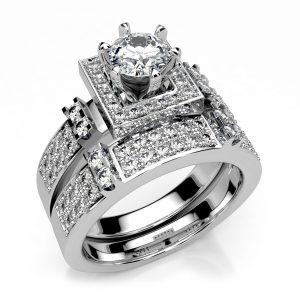 Mestergull To ringer spesilutviklet for kunde i hvitt gull med totalt 73 diamanter. Totalt 1,30 ct. Senterstenen er på 0,50 ct. og brillianter i størrelsen 0,01 ct. og 0,02 ct. er brukt i pavèringen DESIGN STUDIO Spesialdesign Ring