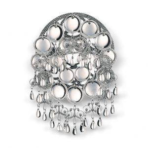 Mestergull Oksidert skålesølje med blanke trådkantløv. Tidligere var skålene på søljene var et vanleg uttrykk for jomfruelighet og slike søljer ble gjerne brukt som forlovelsesgave. NORSK BUNADSØLV Sølje