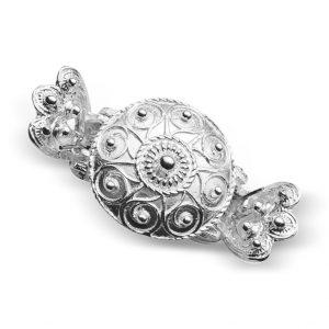Mestergull Hårklype i hvitt sølv til de fleste bunader. Finnes i flere størrelser og farger. NORSK BUNADSØLV Diverse