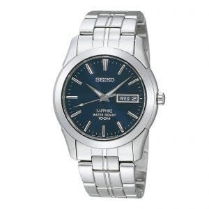 Mestergull Klassisk og stilren klokke med blå urskive med dag/dato visning. Kasse og lenke i rustfritt stål. SEIKO Seiko Ur
