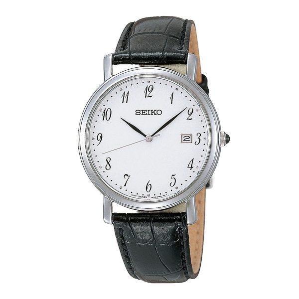 Mestergull Klassisk og elegant klokke med tydelige tall på urskiven. Kasse i rustfritt stål og sort skinnrem. SEIKO Seiko Ur