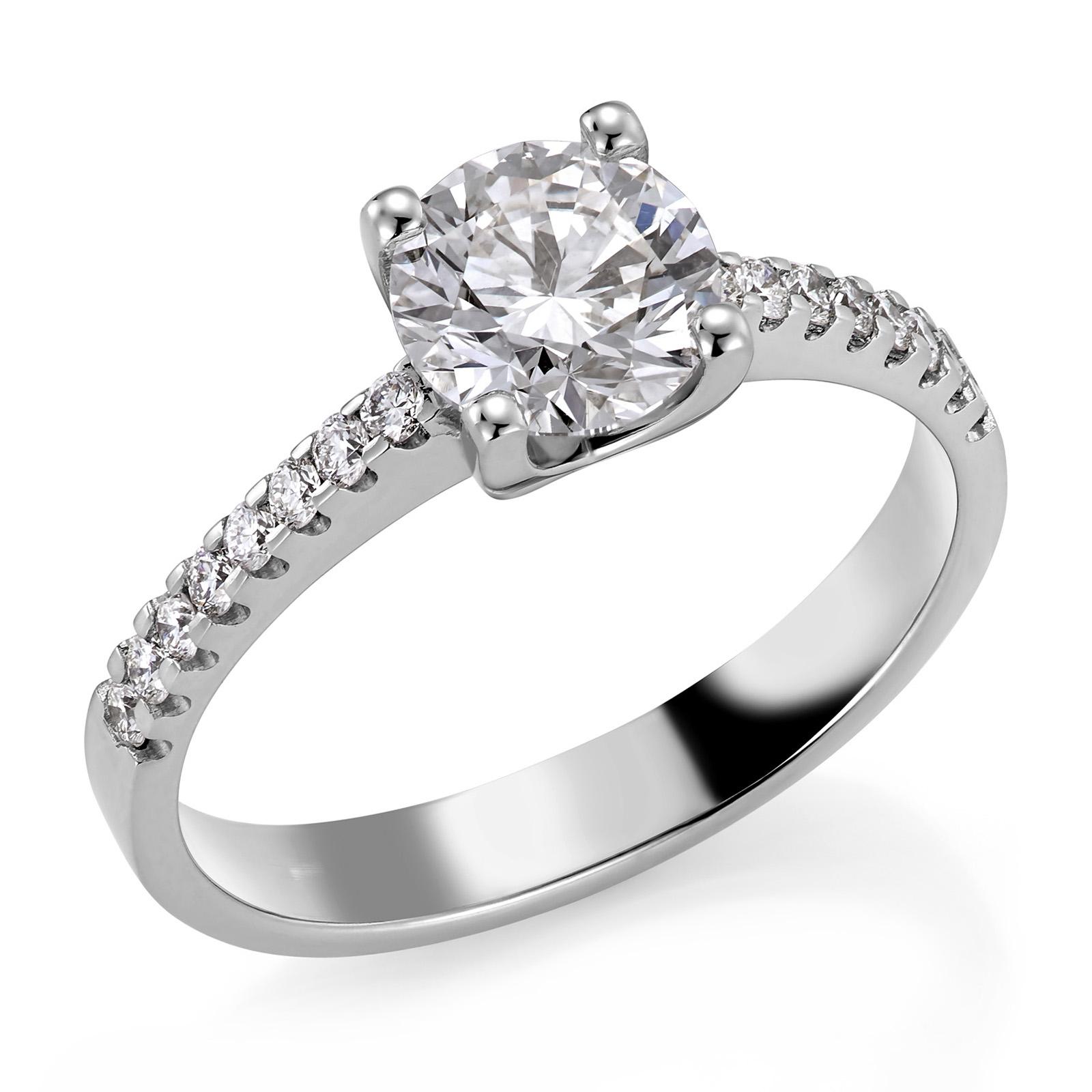 Mestergull Spesialdesignet ring med diamant på 1,00 ct. som sentersten og 16 diamanter i rekke på skulderpartiet. Ringen er utført i hvitt gull 585. Total diamantvekt 1,16 ct. HSI DESIGN STUDIO Solitaire Ring