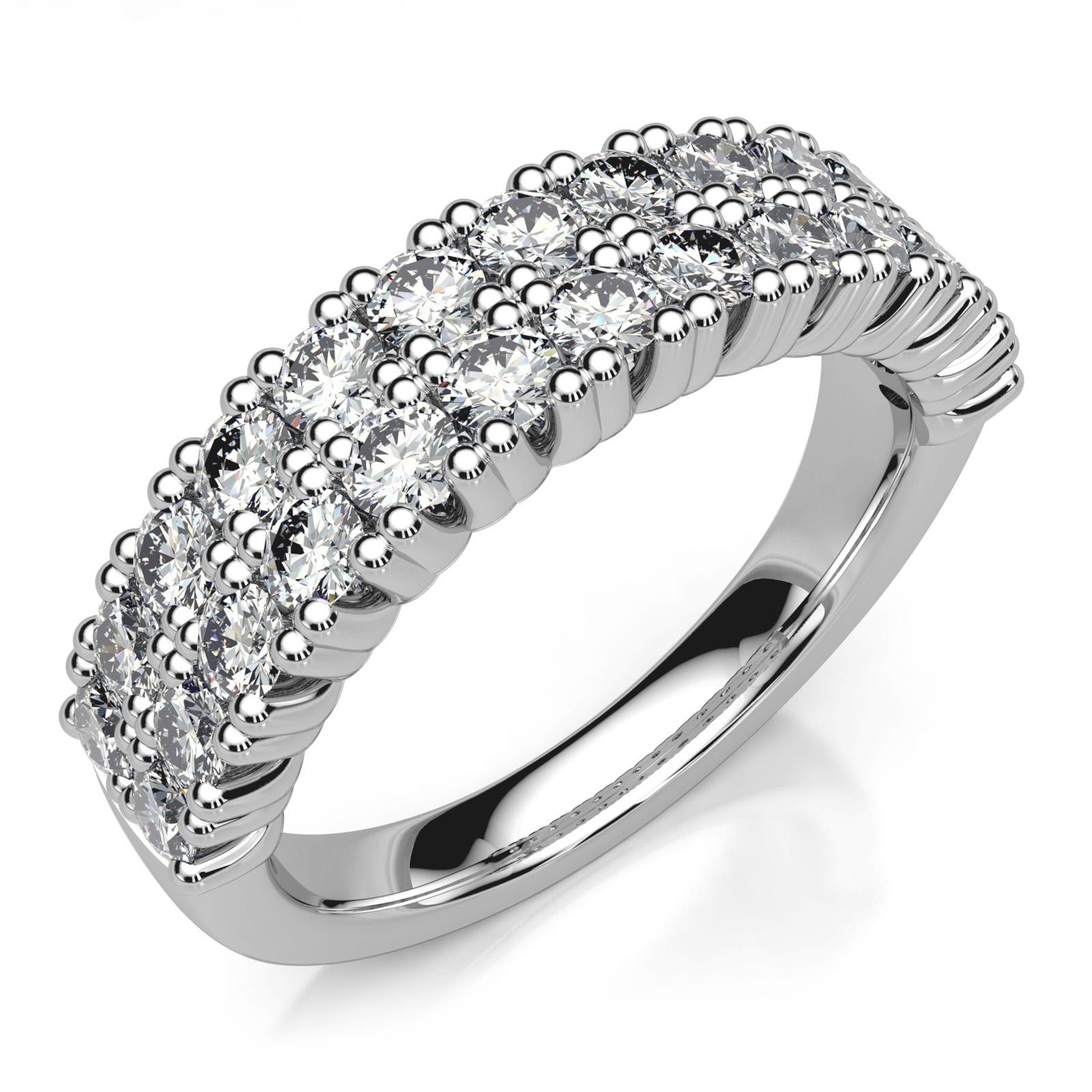 Mestergull Dobbel alliansering laget for å gjenbruke kundens diamanter fra eldre rekkering. Ringen er utført i hvitt gull 585 og fattet med 26 diamanter à 0,05 ct. Totalt 1,30 ct. DESIGN STUDIO Spesialdesign Ring